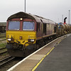 66232 runs through the station with 6O41 Westbury - Eastleigh with 3 x RHTTs and salmons in tow