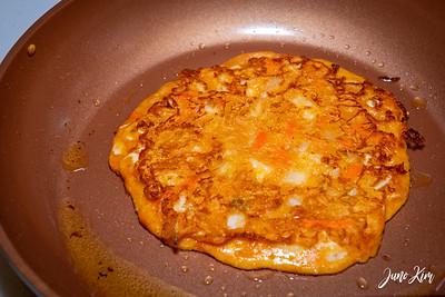 Making kimchi jeon