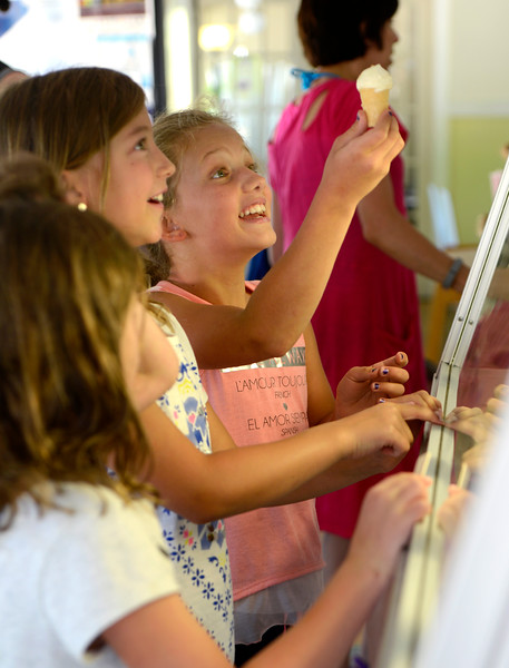 "Jolie Sasseville, 9, left, and Grace Thornton, 10, happily receive ice cream from Eats & Sweets in Lafayette on Tuesday. For more photos go to  <a href=""http://www.dailycamera.com"">http://www.dailycamera.com</a><br /> Devi Chung For The Camera. June 14, 2016"