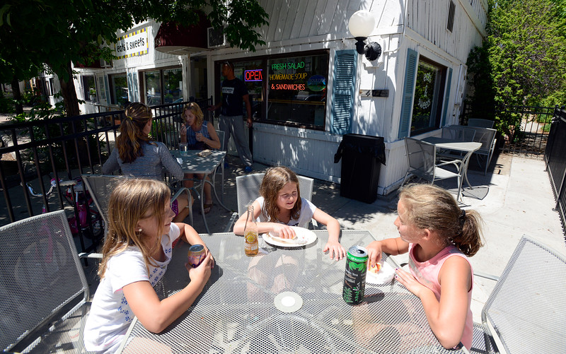 "Gabby Kasic, 8, left, Jolie Sasseville, 9, and Grace Thornton, 10, enjoy the recently added patio area of Eats & Sweets sandwich and bakery shop in Lafayette on Tuesday. For more photos go to  <a href=""http://www.dailycamera.com"">http://www.dailycamera.com</a><br /> <br /> Devi Chung For The Camera. June 14, 2016"