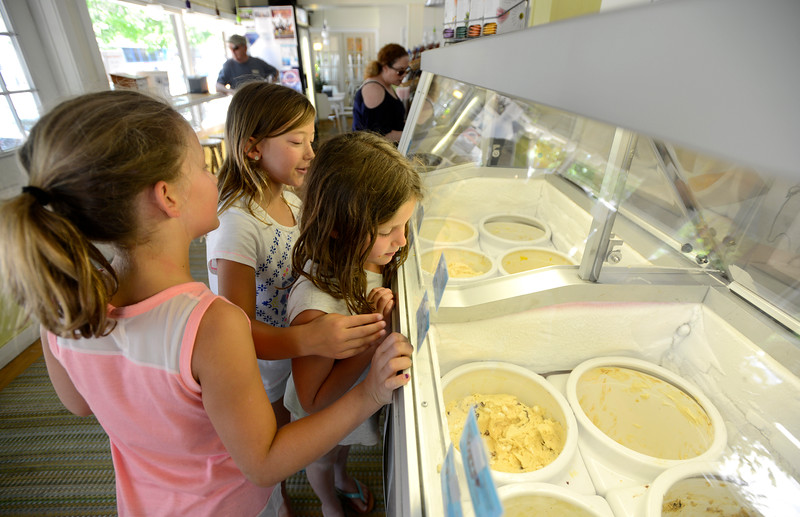 "Grace Thornton, 10, Gabby Kasic, 8, Jolie Sasseville, 9, center, browse the ice cream flavors of Eats & Sweets in Lafayette on Tuesday. For more photos go to  <a href=""http://www.dailycamera.com"">http://www.dailycamera.com</a><br /> Devi Chung For The Camera. June 14, 2016"