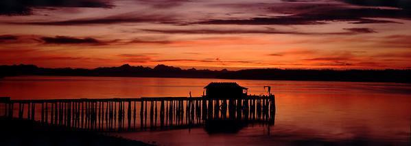 San de Fuca Dawn: looking past the San de Fuca (Whidbey Island) dock, across Penn Cove toward the Cascades. (Original shot on transparency film with Hasselblad XPan)
