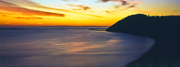 Ebey's Sunset: panoramic sunset at Ebey's Landing National HIstorical Reserve. (Original shot on transparency film with Hasselblad XPan)