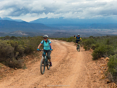 Dave and Joy nearing the top of Rooiberg Pass, Calitzdorp and the Swartberg Mountains in the background. Smooth riding conditions having returned.