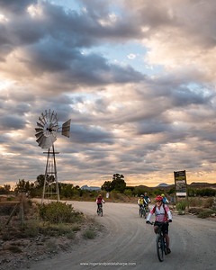 Tony leads the team out of Van Wyksdorp and past the town's iconic windmill at the start of the second day's riding