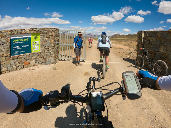 Bruce does the gentlemanly thing and into Anysberg Nature Reserve we pedal.