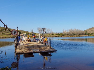 Cyclists at the pont or ferry across the Breede River. Malgas (Malagas). Western Cape. South Africa