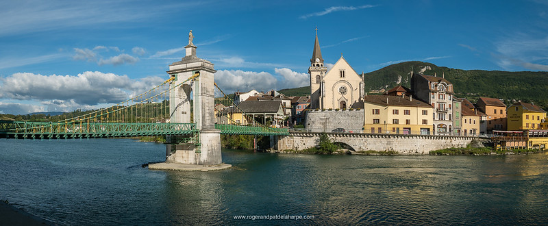 The suspension bridge over the Rhone River and the hotel in which we stayed, the Hôtel Beau Séjour, is the yellow building on the right. Seyssel. France.