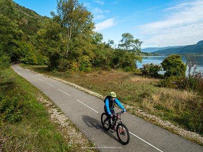 The Rhone River and Pat riding the cycle path or  ViaRhôna near Belley. France