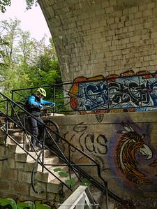 The railway bridge over ethe L'allondon River has this rather unusual walk way underneath it, Switzerland