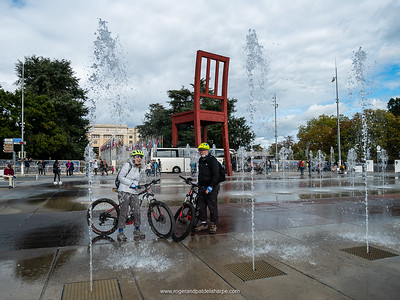 Getting wet at the water fountains at the UN in Geneva, the Broken Chair sculpture in the background. Switzerland