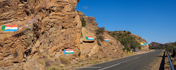 Many of the flags used in South Africa's past are painted on the rock faces in Noorspoort just outside Steytlerville. It's become known as the Valley of Flags.