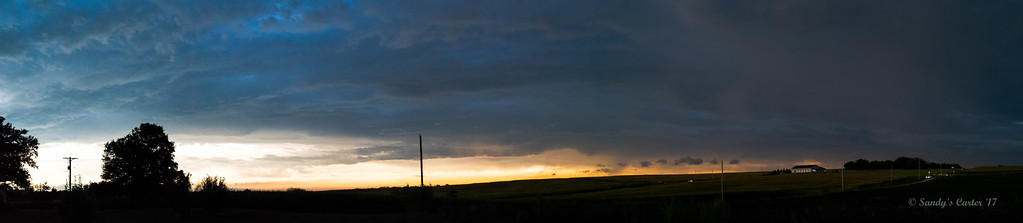 This a panorama of the sky looking north.  Notice the cars in the lower right corner with their headlights on.