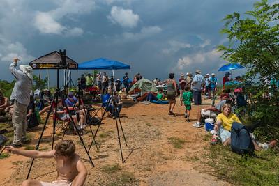 Cameras, tents and spectators.