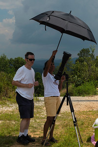 Dude at least hold the umbrella.