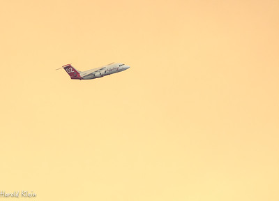 Fire fighting plane against the yellow sky