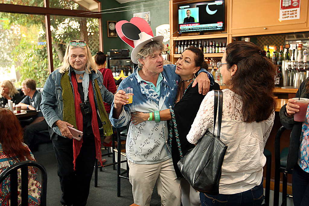 . Even though the fog never lifted at the Summit House Beer Garden & Grill, eclipse viewing party host Rupert Hart of Aptos maintained a party atmosphere for dozens of guests Monday morning. (Dan  Coyro -- Santa Cruz Sentinel)