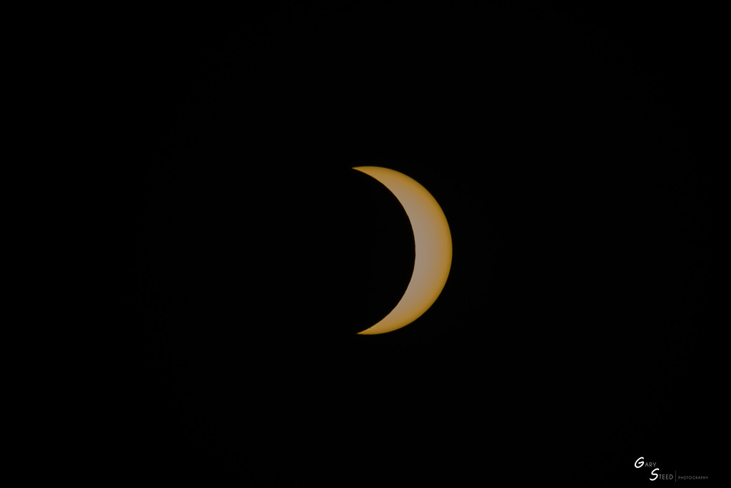 . The moon covers about 75 percent of the sun at peak of the eclipse over Santa Cruz County on Monday, as seen from Crest Ranch. (Gary Steed -- Contributed)