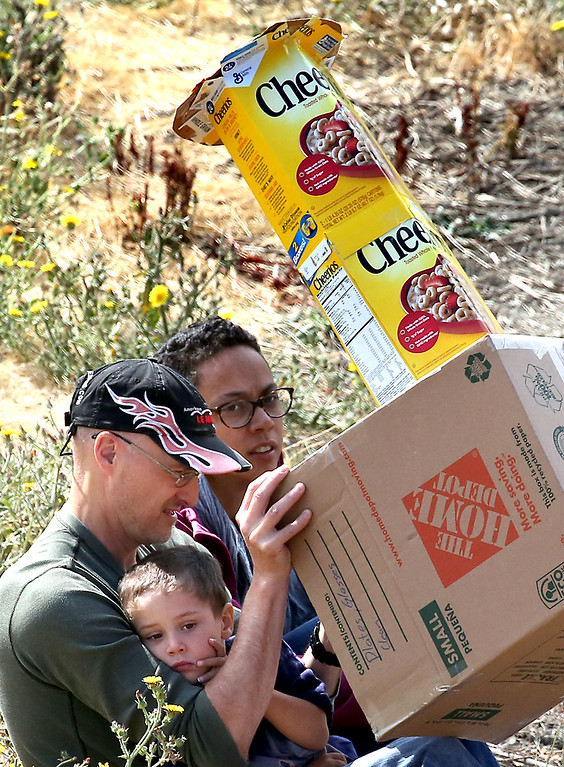 . One of many homemade eclipse-watching contraptions deployed along Alma Creek Road near the Lexington Reservoir in Santa Clara County Monday. (Shmuel Thaler � Santa Cruz Sentinel)