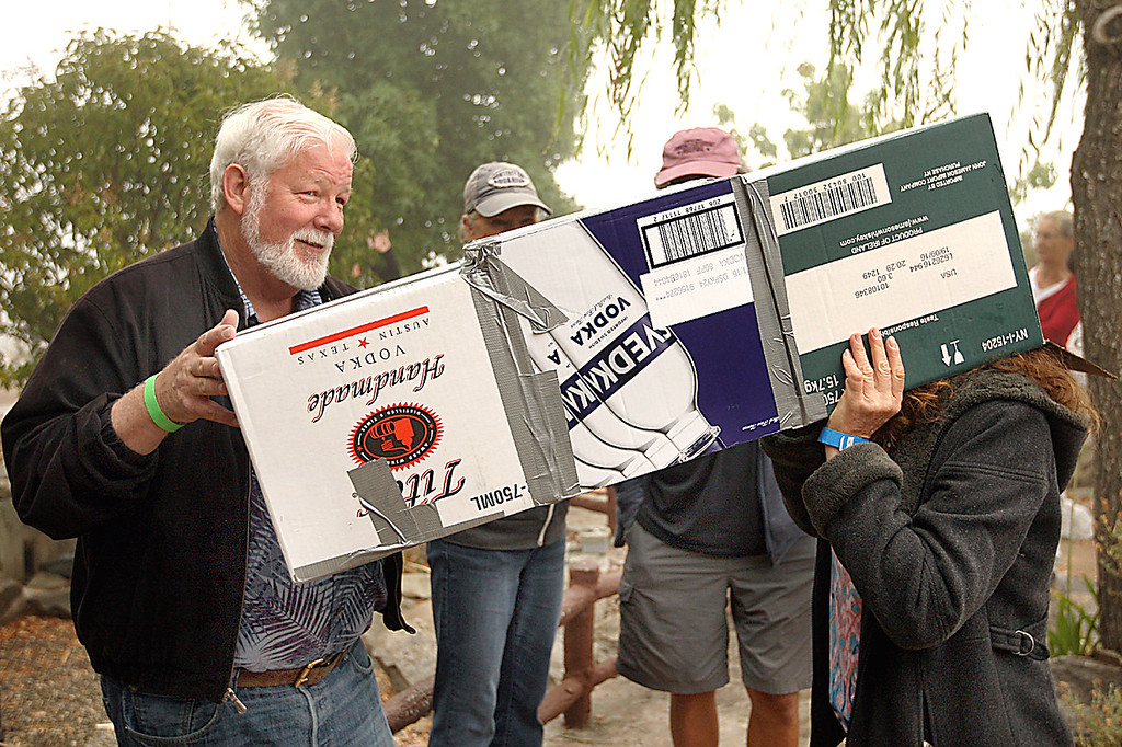. Terry Leonard of Aptos brought a \'viewing box\' to the eclipse party at the Summit House Beer Garden & Grill into which disappointed eclipse seekers put their heads into one end of the box to see a picture of the eclipse pasted to the other end of the box. (Dan Coyro -- Santa Cruz Sentinel)