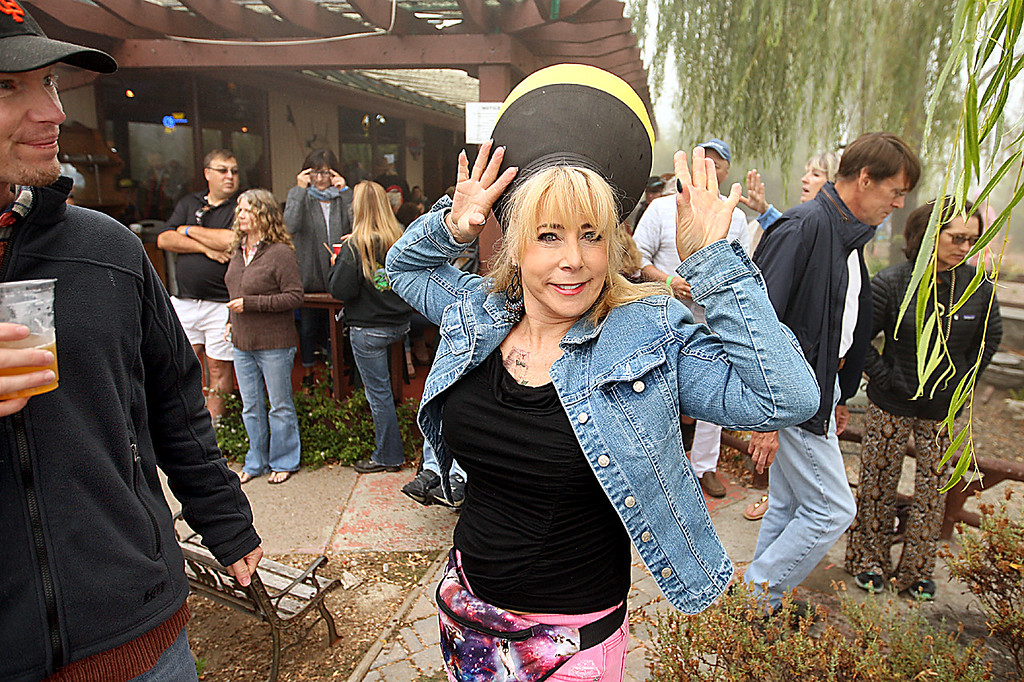 . Judy Shapiro of Los Gatos shows off her eclipse hat--a two tone visor worn upside down--at Summit House Beer Garden & Grill\'s eclipse viewing party Monday morning. The fog never lifted in time to view the long-awaited eclipse. (Dan  Coyro -- Santa Cruz Sentinel)