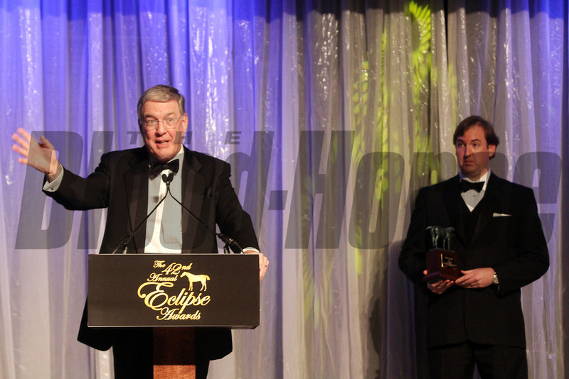 Nick Nicholson accepts the Award of Merit presented by his son Nick Nicholson Jr. at the  2013 Eclipse Awards at Gulfstream Park, FL<br /> <br /> Photos by Z