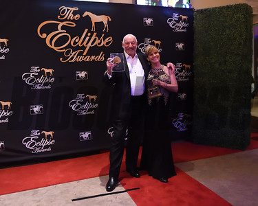 Jack Wolf and Barbara Livingston show off their trophies at the Eclipse Awards credit Leslie Martin