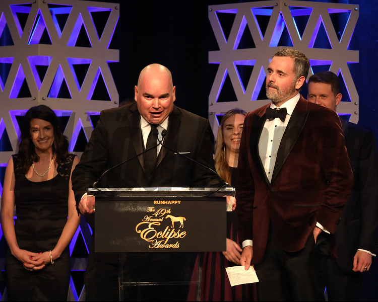 Justin Border speaking while partner Ryan Exline and friends look on,  2YO Male, 2019 Eclipse Awards at Gulfstream Park, Fort Lauderdale Fl held January 23, 2020