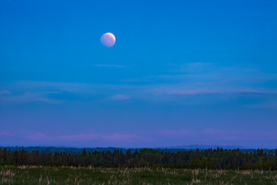 Red Moon over the Rose Colored Rockies