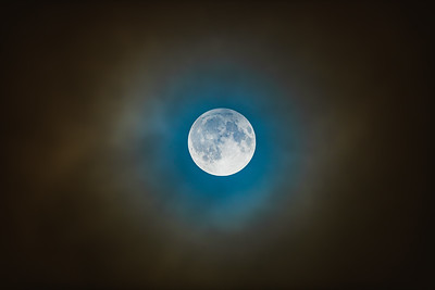 Penumbral Lunar Eclipse in Clouds