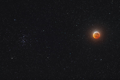 Eclipsed Moon Beside the Beehive
