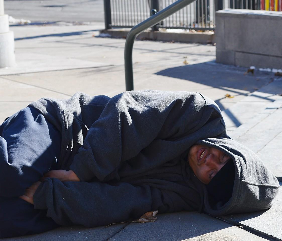 Homeless man sleeping on Denver street.