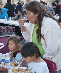 Denver residents attend a free Thanksgiving dinner and clothing give-away, sponsored by a coalition of local churchs, at Civic Center Park. (11/12/11)