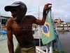 A man stands on a riverboat beside the Brazilian flag in the Amazonian state of Para.(Australfoto/Douglas Engle)