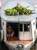 A boy sits on a riverboat loaded bananas during the weekly market day in a small town in the Amazonian state of Para. (Australfoto/Douglas Engle)
