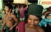 Manaus, Brazil, dock workers unload boats on the Amazon River. (Australfoto/Douglas Engle)