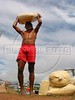 A worker carries manioc flour at riverside in the Amazonian state of Para.(Australfoto/Douglas Engle)