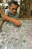 A man sells old Brazilian coins in a plaza in Sao Paulo.(Douglas Engle/Australfoto)