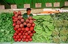 A man sells vegetables in a street market in Sao Paulo. (Douglas Engle/Australfoto)