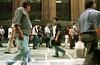 Pedestrians walk past a line for job applicants in Sao Paulo. (Douglas Engle/Australfoto)