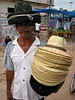 A vendor offer hats during the weekly market day in a small town in the Amazonian state of Para. (Douglas Engle/Australfoto)