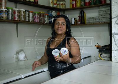 Trader Ângela Baptista de Souza in her bar at Cidade de Deus slum, Rio de Janeiro, Brazil, September 15, 2011.  The Brazilian favela City of God, received today the first branch of Community Bank, as a new experience to stimulate the activity economic in poor communities. (Austral Foto/Renzo Gostoli)