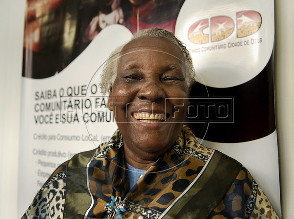 Geralda Maria de Jesus, 82, notable citizen of the favela Cidade de Deus (City of God), who illustrated one of the bill, social currency Cidade de Deus, issued by the Community Bank of Cidade de Deus, Rio de Janeiro, Brazil, September 15, 2011.  The Brazilian favela City of God, received today the first branch of Community Bank, as a new experience to stimulate the activity economic in poor communities. (Austral Foto/Renzo Gostoli)