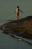 A boy walks on the lakeside of the artificial lake formed by the Itaipu Hydroelectric plant.(Douglas Engle/Australfoto)