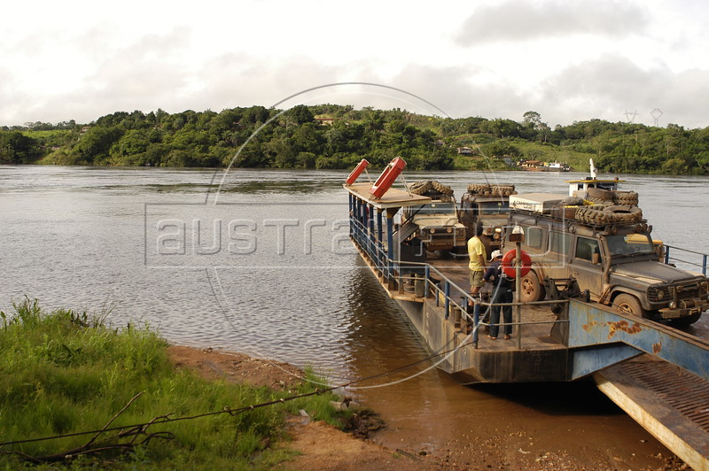 Cars cross the the XIngu River on a ferry which connects the transamazon highway in Altamira  in the Amazonian Brazilian state of Para.  Business people in the region support plan to build a hydro electric station near the city, reasoning it will bring jobs to the region. Sceptics argue that flooding the region will impact the environment and that any energy from an eventual station will not even serve the region.(AustralFoto/Douglas Engle)
