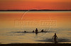 Bathers swim in the artificial lake formed by the Itaipu Hydroelectric plant as the sun sets over Paraguay, background.(Douglas Engle/Australfoto)