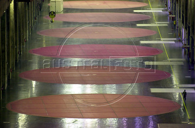 A worker, lower right, walks in the main hall about the electric turbines at the Binational Itaipu Hydroelectric plant in Foz do Iguacu, Brazil, and Ciudad del Este, Paraguay.(Douglas Engle/Australfoto)