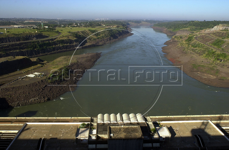 The Parana River, which forms the border between Brazil, left, and Paraguay, right,  flows out of the Binational Itaipu Hydroelectric plant in Foz do Iguacu, Brazil, and Ciudad del Este, Paraguay.(Douglas Engle/Australfoto)
