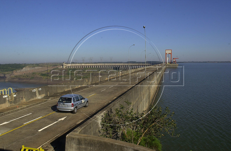 A car drives over the barrier wall which forms the artifical Itaipu lake at the Binational Itaipu Hydroelectric plant in Foz do Iguacu, Brazil, and Ciudad del Este, Paraguay.(Douglas Engle/Australfoto)