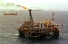 Natural gas burns off at the Petrobras Palataforma 26, about 100 miles from the Brazilian coastline in the Campos Basin of the Atlantic Ocean. With the discovery of new oil deposits in the basin, Brazil hopes to start producing 2 million barrels a day, thus becoming self-sufficient.(Douglas Engle/Australfoto)